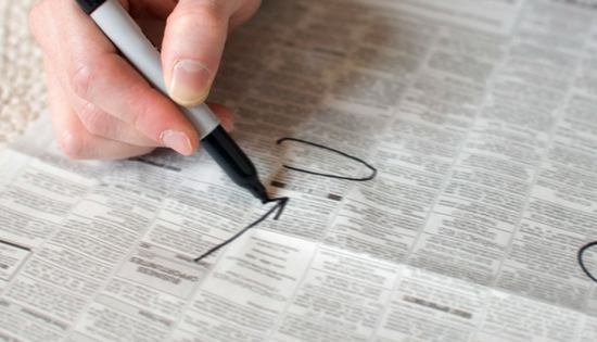 Circling jobs in newspaper classifieds